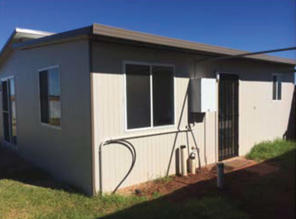 This quality, affordable Quickbuilt modular DIY kit home, The Kimberley, features 2 bedrooms, a large living and kitchen area, and a spacious bathroom.